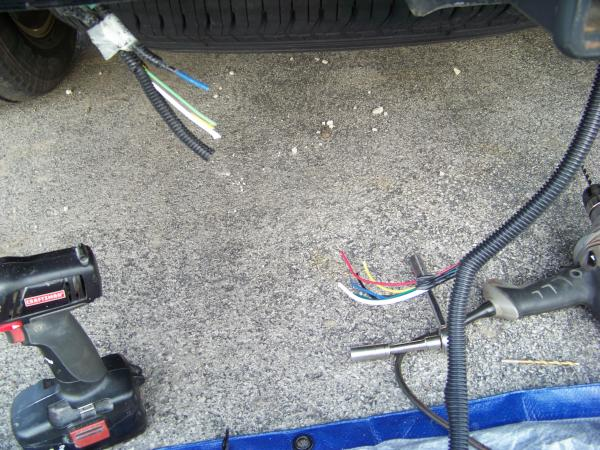 installing a 7 blade rv connector on a ford expedition blue oval the 4 pin plug is cut from the factory harness and the cap is cut off of the end of the factory blue trailer brake wire the factory harness is then